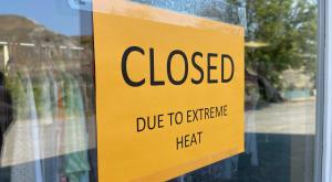 """Sign on storefront in Ashcroft BC with text """"Closed due to extreme heat"""""""